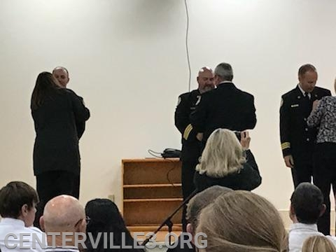 District Chief Kevin Jones being pinned by Lt. Steve Parrott
